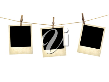 Royalty Free Photo of a Polaroids on a Clothesline