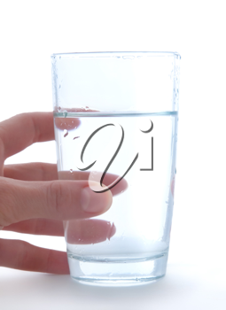 Glass of clean water in hand isolated on a white background