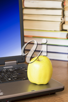 Royalty Free Photo of an Apple on a Laptop