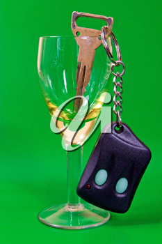 Royalty Free Photo of Car Keys in a Wine Glass