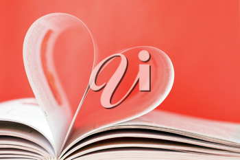 Royalty Free Photo of a Heart Shape in a Book