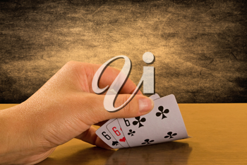 Royalty Free Photo of a Person Playing Cards