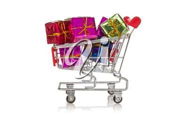 Shopping  cart with colorful gift boxes. Isolated on white background