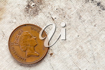 One penny on canvas background with copy - space