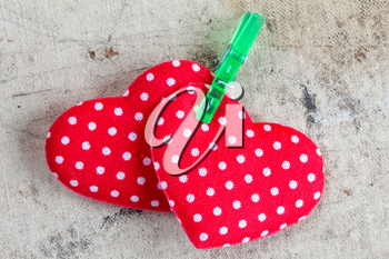Red fabric Valentine hearts with green clothespin