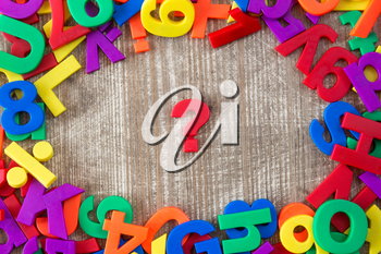 Border of colorful letters and numbers with question mark in a middle