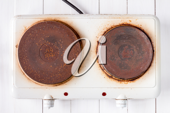 Top view of old rusty electric cooker