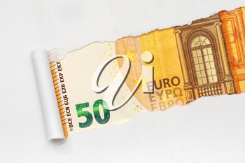 Fifty Euro bill in torn white paper frame