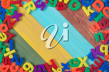 Border of colorful letters and numbers with copy-space