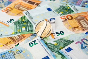 Gold Bitcoin coin on bills of euro banknotes. Worldwide virtual internet cryptocurrency and digital payment system