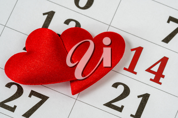 Valentine's day, February 14 on the calendar with red hearts