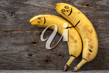 Couple of bananas hugging each other .Concept of embracing couple in love and tenderness.