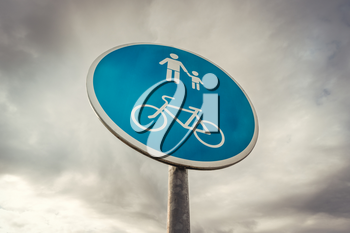 Cyclist & pedestrian road sign on the sky background