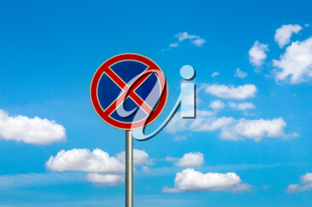 No parking traffic sign on the cloudy sky background.Do not stop traffic sign