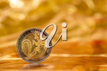 Two Euros on a gold background with nice bokeh