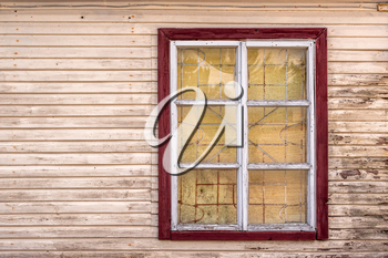 Old wooden window with metal grid. Wall of house, vintage grunge exterior