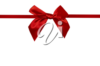 Red ribbon with bow with tails, copy space