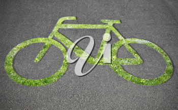 Grass bicycle sign on the road