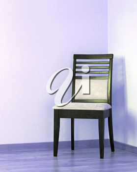 Empty chair on floor and  blank wall
