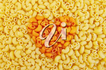 Texture units of the yellow and orange pasta with the image of the heart in the middle