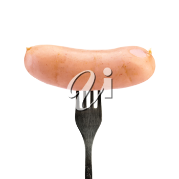 Sausage on a silver fork isolated on white background