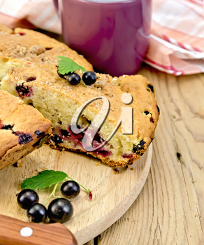 Royalty Free Photo of Currant Cake on a Board With a Knife