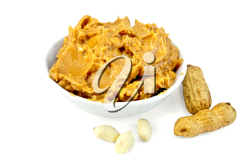Peanut butter in the bowl, peanuts in the shell and cleaned isolated on white background