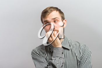 Closeup portrait of thinking man with finger in mouth, sucking thumb, biting fingernail in anxiety, stress, deep in thought, isolated on white background. Negative emotion, facial expression, feelings