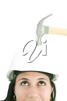 girl with safety helmet about to be hit by a hammer over a white background
