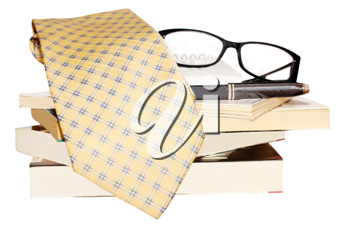 Pen, lens, pile of books and tie