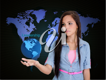 Businesswoman holding a world saying leadership