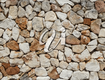 Seamless rough medieval  stone wall background.