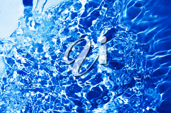 Blue transparent water splashes on white background