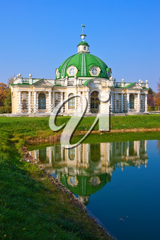 Grotto pavilion with beautiful reflection in park Kuskovo, Moscow, Russia
