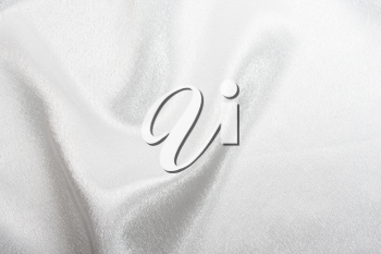 Abstract background white silk fabric with beautiful waves