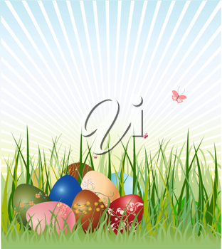 Royalty Free Clipart Image of Easter Eggs in Grass