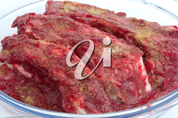 Royalty Free Photo of Pork Ribs in Cranberry Sauce