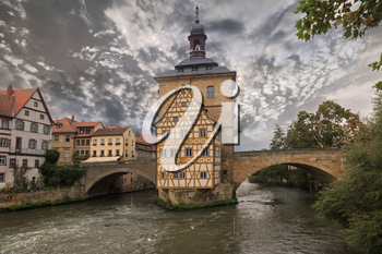 Obere bridge and Altes Rathaus and cloudy sky in Bamberg, Germany, sepia toned