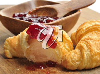 Royalty Free Photo of Jam on a Croissant