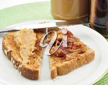 Peanut Butter toasts  and  jars on white background