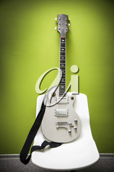 Electric guitar, green wall on the background