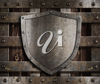 Royalty Free Photo of a Metal Shield on a Door