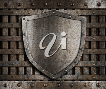 Royalty Free Photo of a Shield on a Gate