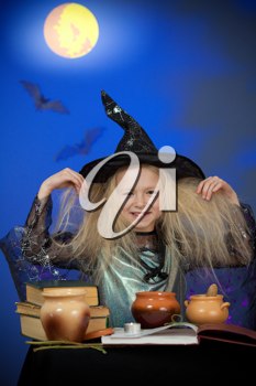 Royalty Free Photo of a Girl Dressed as a Witch