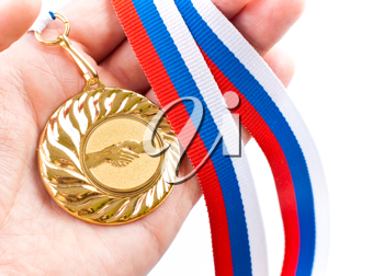 Royalty Free Photo of a Person Holding a Gold Medal