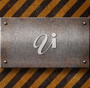 Royalty Free Photo of a Metal Plate Over Hazard Stripes