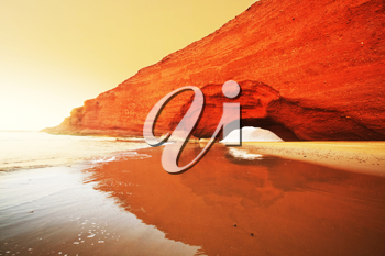 Royalty Free Photo of an Arch Formation on the Beach in Morocco