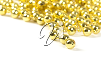 Background made of a brilliant celebratory beads of golden color over white