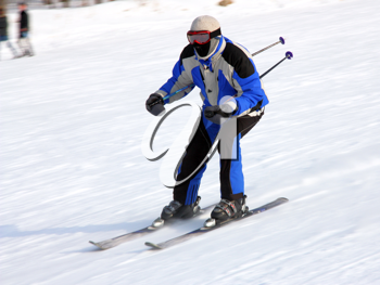 The skier quickly goes from mountain in winter equipment