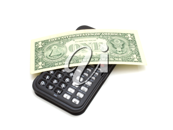The black calculator on a white background and on it lies one dollar a denomination